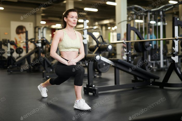 Sportswoman Stretching in Gym