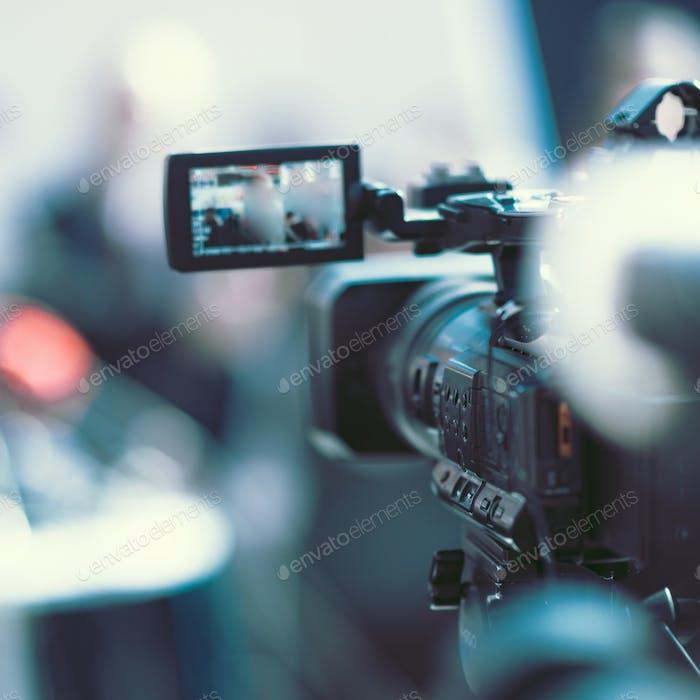 Camera at a media conference