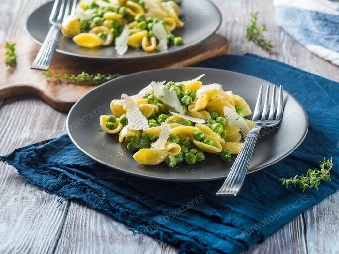 Italian orecchiette pasta with peas and cheese