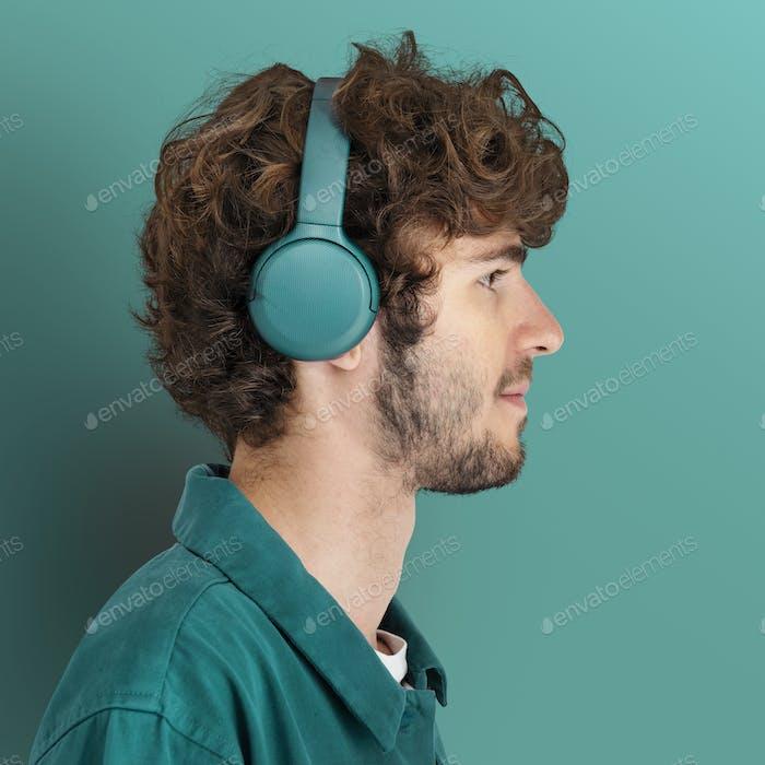 Man mockup listening to music using headphones Pinterest banner