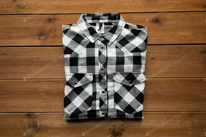 checkered shirt on wooden background