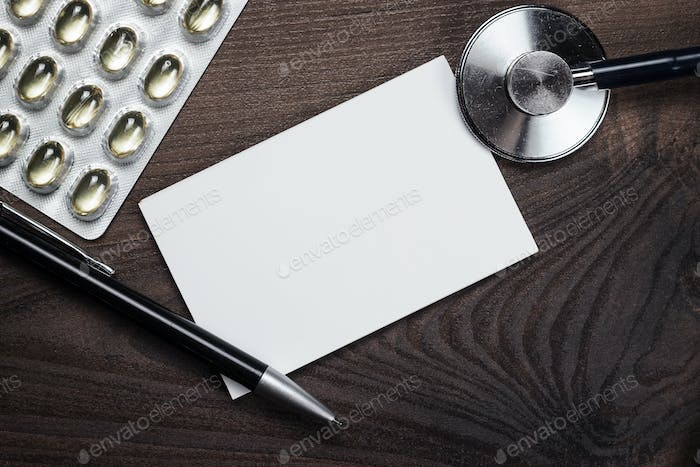 Blank Notebook Statoscope And Pills On The Table