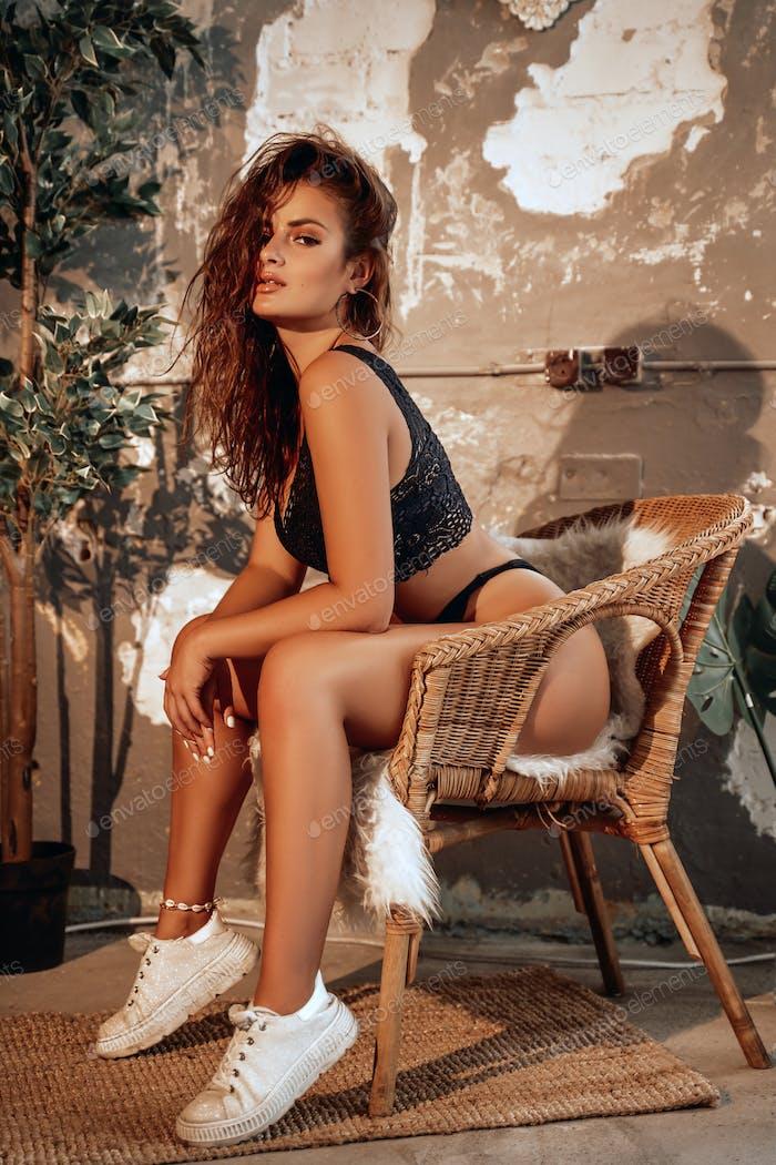 Pretty woman sitting on comfortable armchair