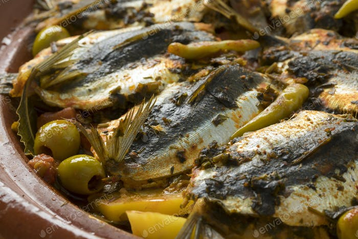 Traditional  Moroccan Tagine with stuffed sardines and vegetable