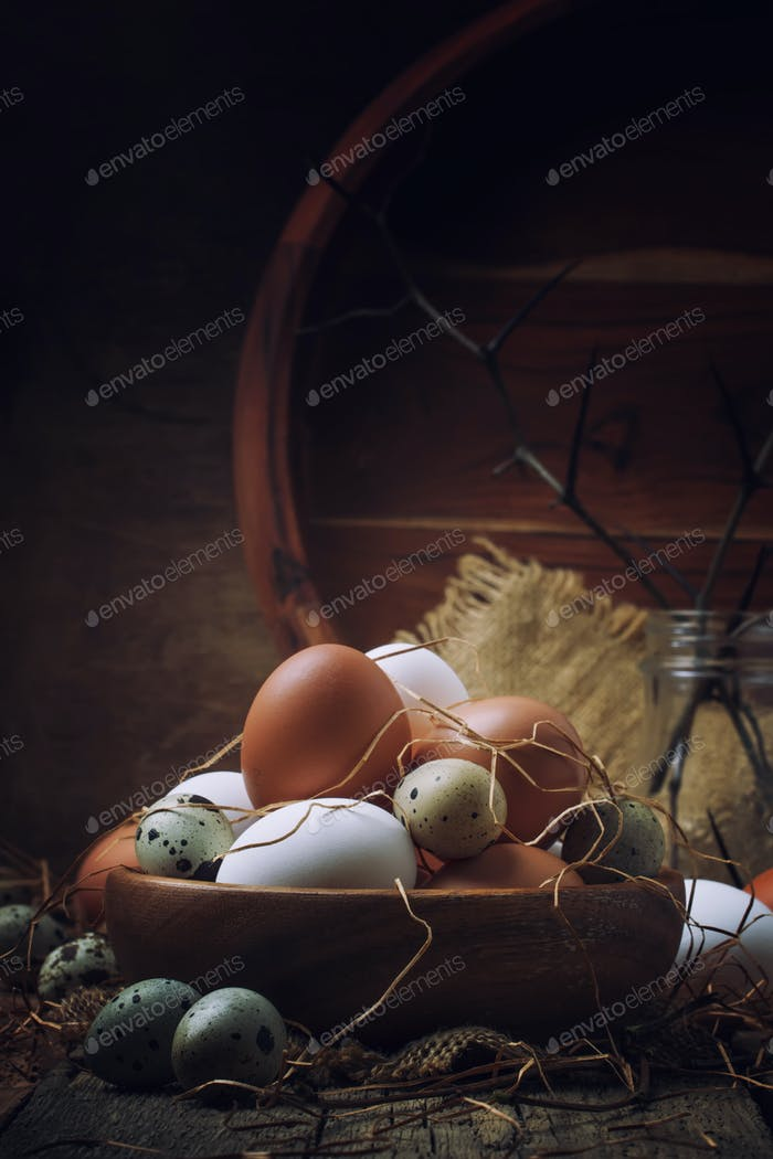 chicken and quail eggs in rustic style