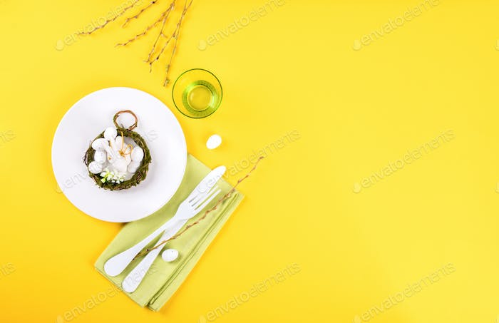 Easter table setting  on a bright yellow background