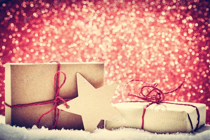 Thumbnail for Retro rustic Christmas gifts, presents in snow on glitter background