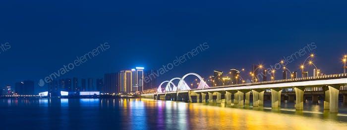 beautiful jiujiang night view of lake and bridge in new district, jiangxi, China