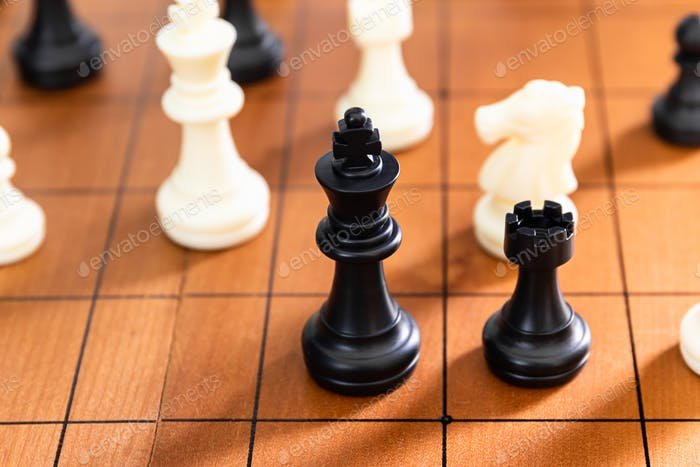 Chess pieces on wood chessboard