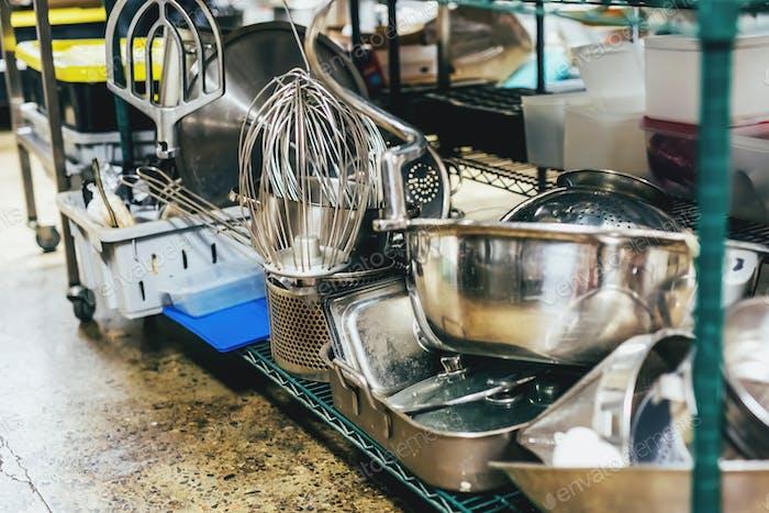 Kitchen utensils on shelves in an industrial kitchen