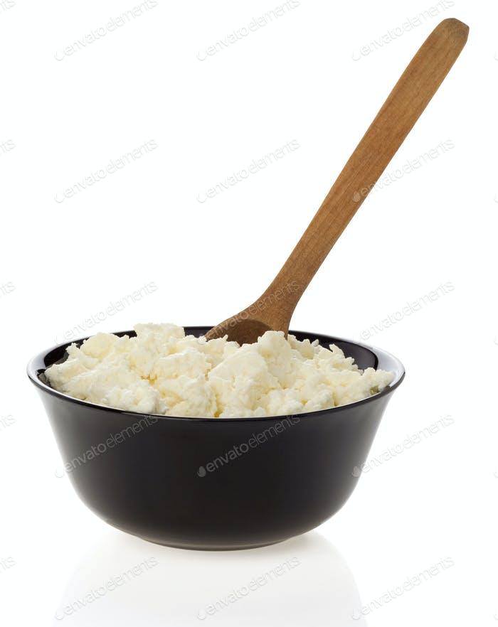 cottage cheese and spoon in bowl