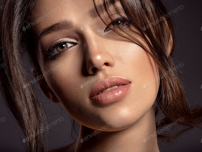 Beautiful woman with brown hair. Attractive model with brown eye