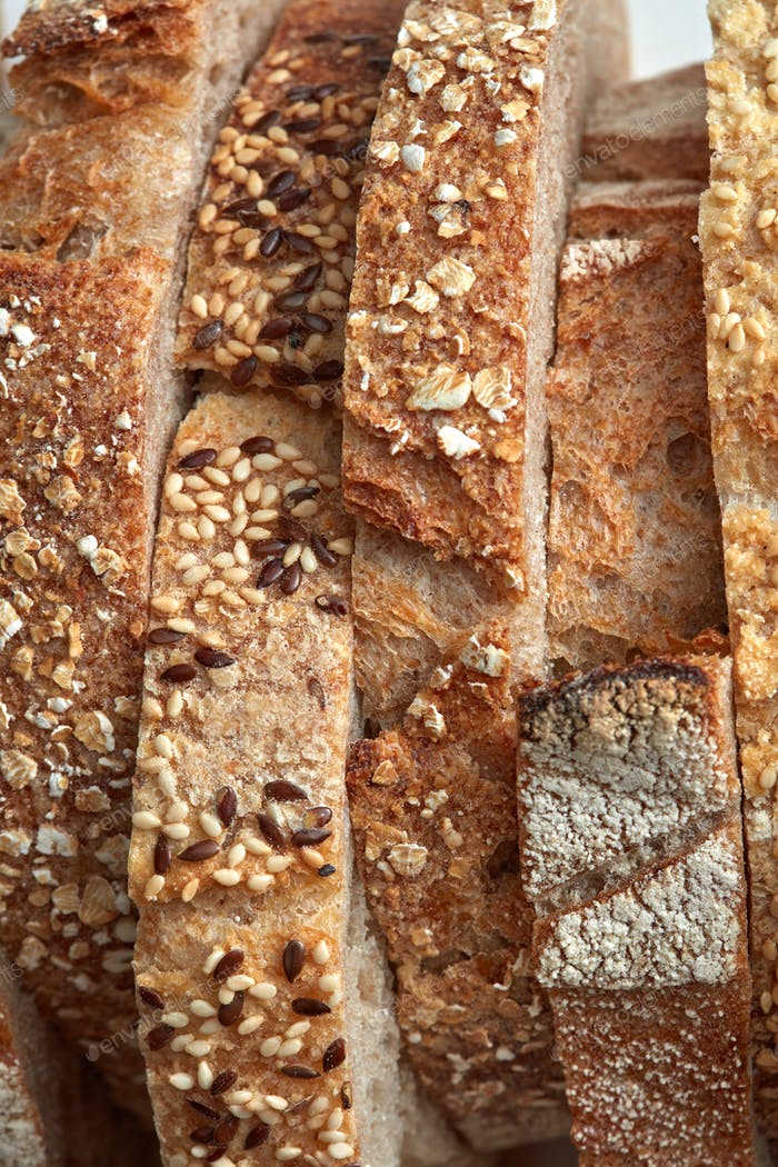 Macro photos of slices of homemade, grain bread with sesame seeds and flax. Organic Healthy Food