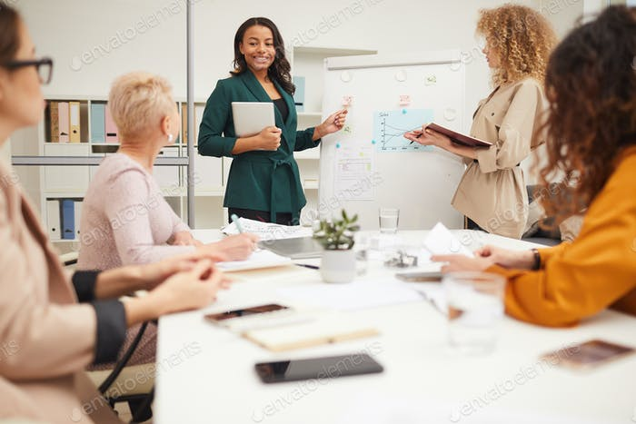 Young Female Colleagues Making Presentation