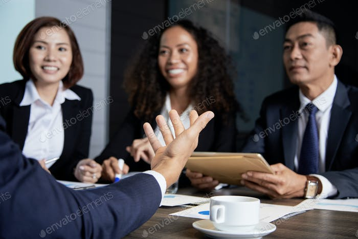 Communicating businesspeople on meeting