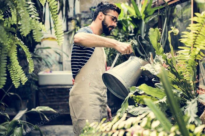 White man taking care of the plants