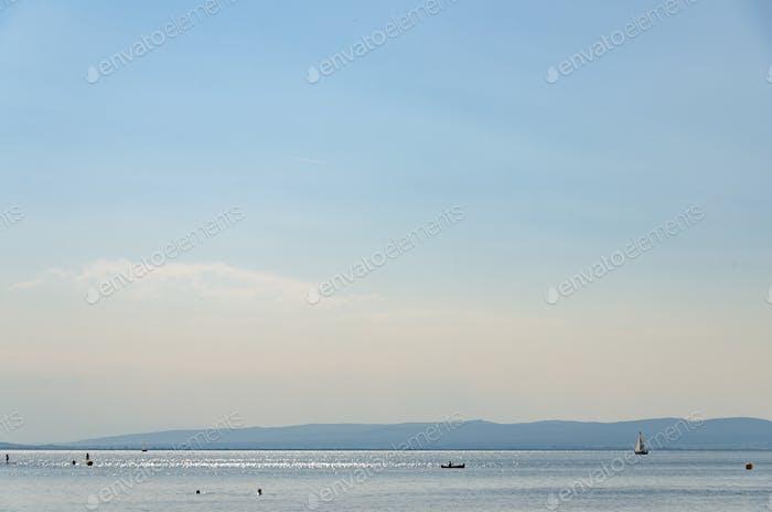 The famous Lake Neusiedl,Burgenland, people swimming, boats sailing on lake