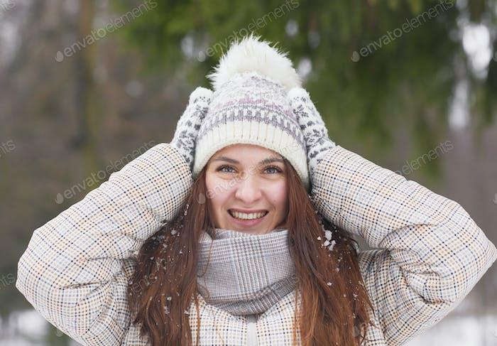Smiling Woman Enjoying Winter Outdoors