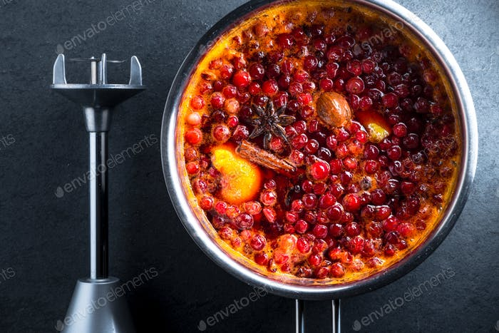Stewed with ingredients for cranberry sauce and blender