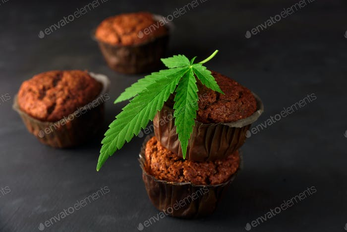 Chocolate muffin with cannabis leaf