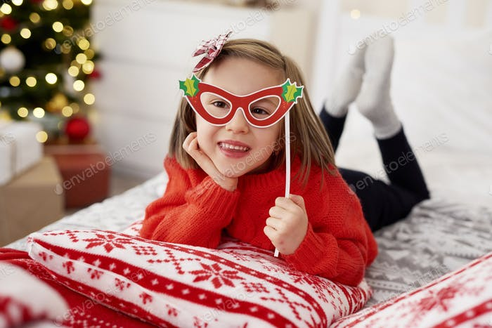 Portrait of playful girl in Christmas mask