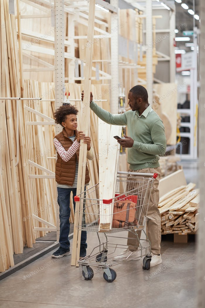 Father and Son Buying Wooden Panels in Home Improvement Store
