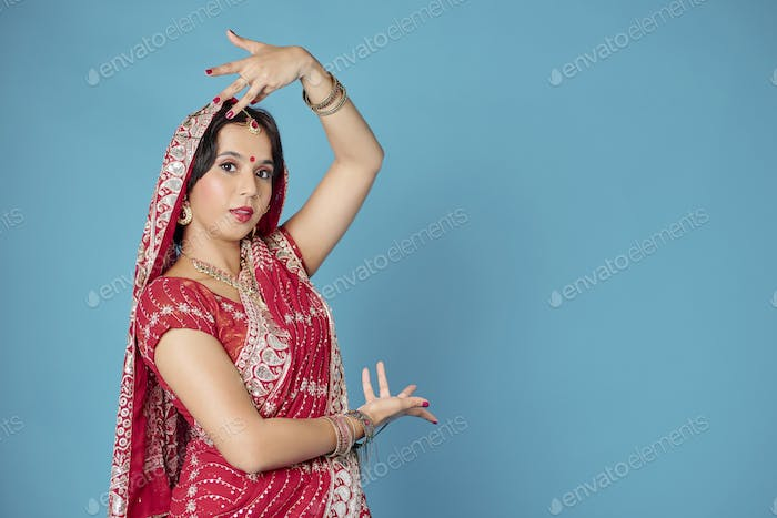 Woman dancing in traditional dress