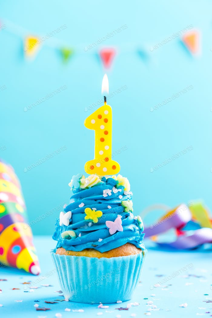 First 1st birthday cupcake with candle and sprinkles. Card mocku