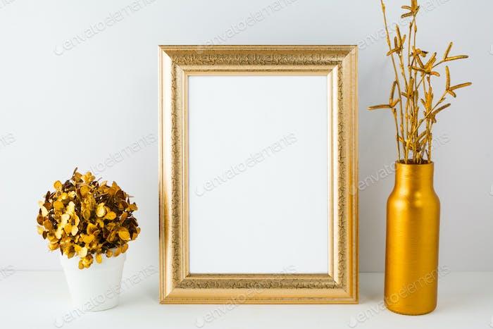 Frame mockup with golden vase