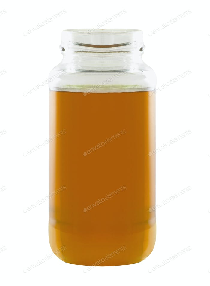 honey in a jar isolated on white