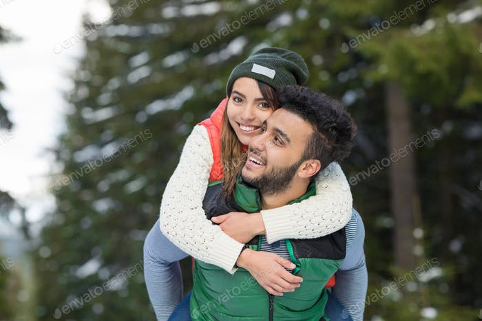 Young Mix Race Couple Snow Forest Outdoor Winter Walk