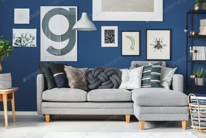 Pillows on grey corner sofa