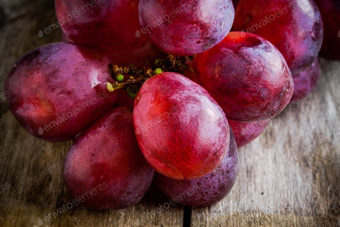 organic ripe grapes closeup on wooden background
