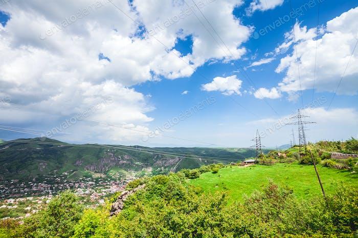 village with green hills