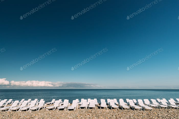 Many Sun Loungers By The Sea. Chaise-longues, Chaise Longue On B