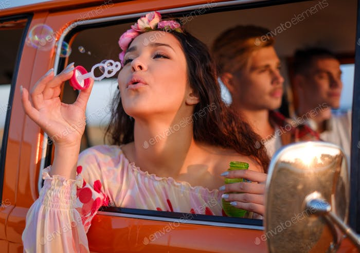 Hippie friends in a van on a road trip
