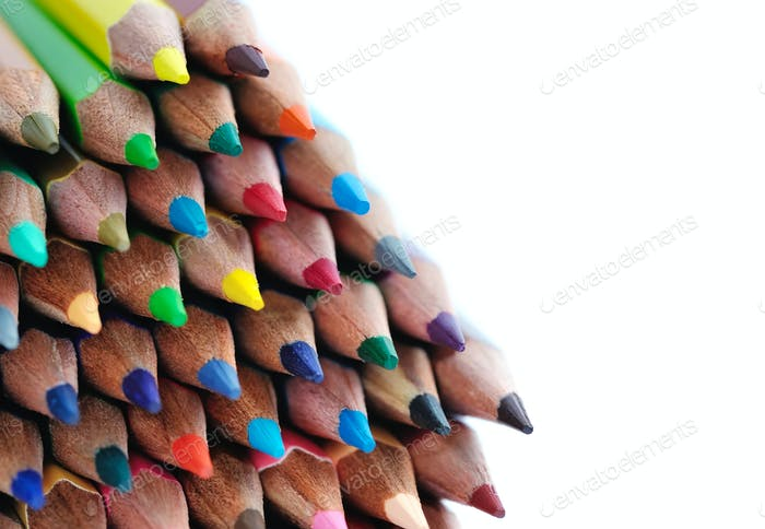 Close-up of colour pencils on white background