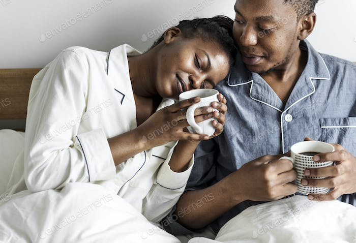 A couple having coffee in bed