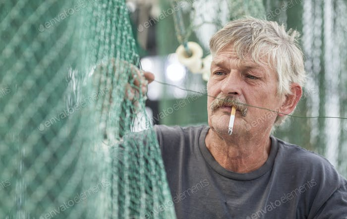 fisherman mending nets