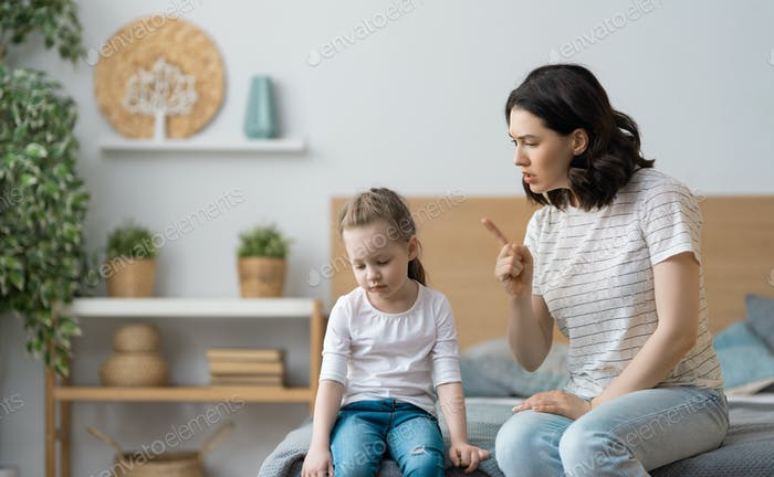 mother is scolding her child girl.