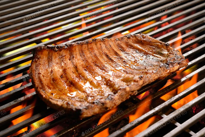 Grilled pork ribs/steak on the flaming grilled