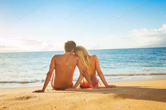 Couple Watching the Sunset on Tropical Beach Vacation