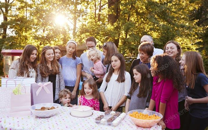 Friends and family in garden celebrating a childÕs birthday