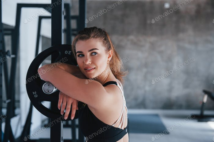 Attractive young girl. Photo of gorgeous blonde woman in the gym at her weekend time