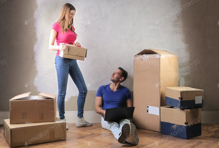 Couple with boxes in a new house