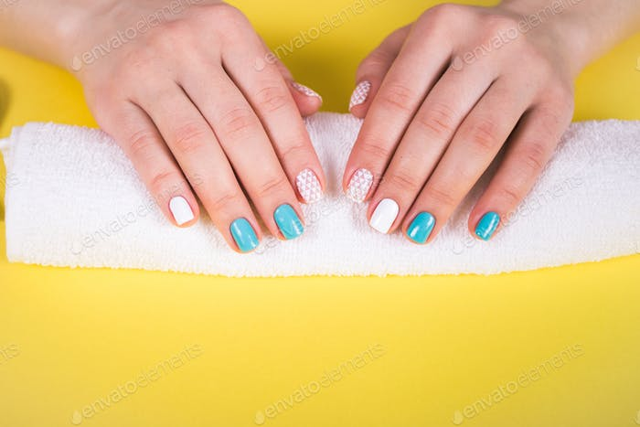 Thumbnail for beautiful manicure. gel polish coating in white and turquoise, stamping.
