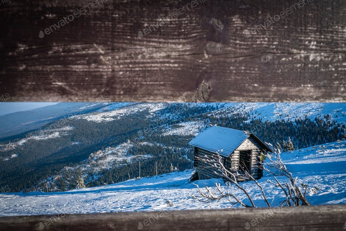 Small wooden hut on the slope of Szrenica