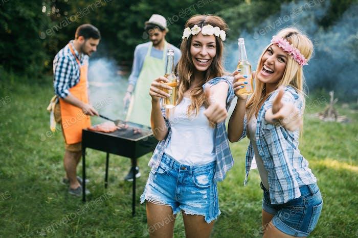 Two beautiful women having fun while waiting for barbecue