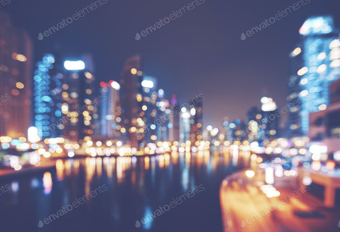 Color toned blurred picture of Dubai Marina at night.