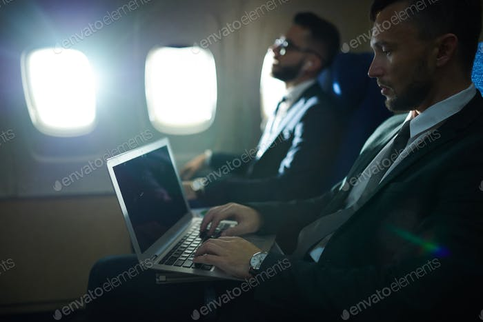 Business People in Plane
